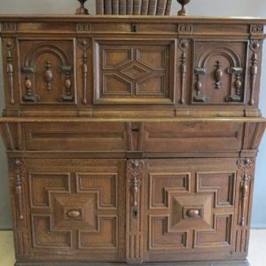 A 17TH CENTURY COFFER TOPPED CHEST OF DRAWERS