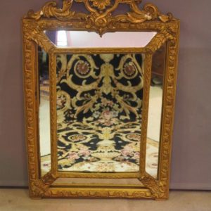A 19TH CENTURY GILDED MIRROR