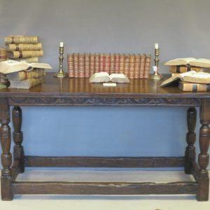 A 17TH CENTURY OAK KITCHEN TABLE