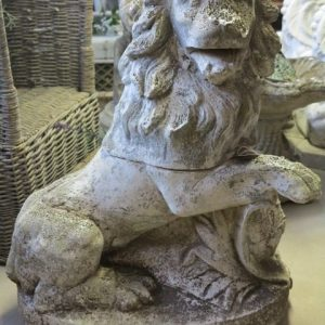 A WEATHERED RECONSTITUTED STONE LION