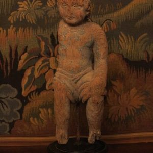 AN 18TH CENTURY CARVED FIGURE