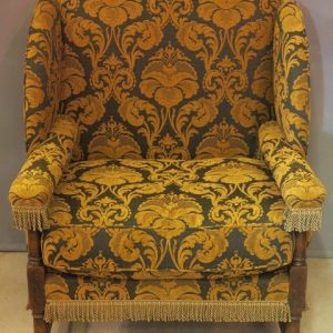 A 19TH CENTURY UPHOLSTERED ARMCHAIR