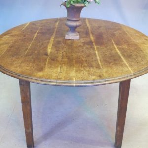 A LARGE FRENCH OVAL DINING TABLE