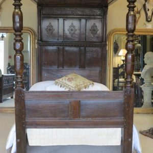 A 17TH CENTURY TESTER BED
