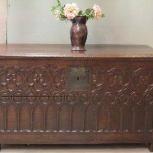 A 17TH CENTURY CARVED COFFER