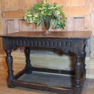 A 17TH CENTURY OAK CENTRE TABLE