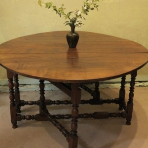 A LARGE OVAL GATELEG TABLE