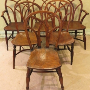 A SET OF SIX GOTHIC DINING CHAIRS