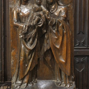 A 17TH CENTURY CARVED OAK PANEL
