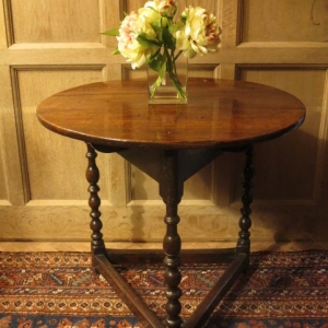 A 17TH CENTURY CRICKET TABLE