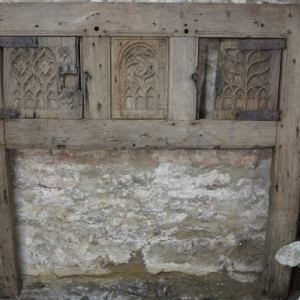 AN EARLY GOTHIC CUPBOARD FRONT