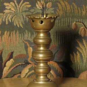 AN 18TH CENTURY CANDLESTICK