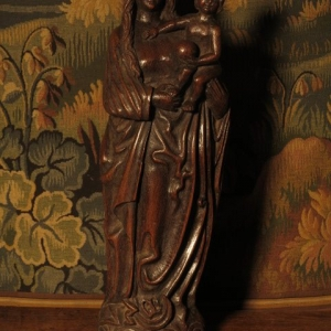 AN 18TH CENTURY OAK MADONNA AND CHILD