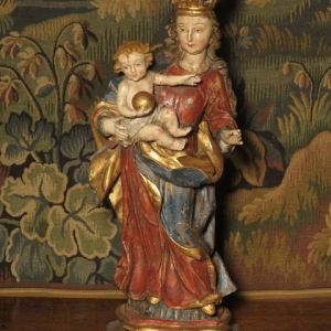 AN 18TH CENTURY CARVED MADONNA AND CHILD
