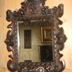AN 18TH CENTURY CARVED MIRROR