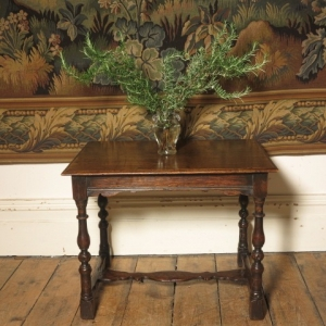 A LOW 19TH CENTURY CENTRE TABLE