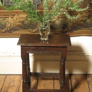 A 17TH CENTURY JOINT STOOL